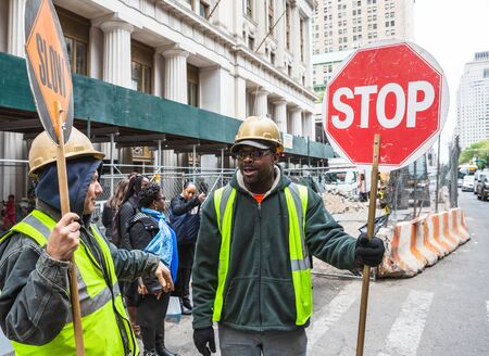 NEW YORK, USA - Apr 29, 2016: Manhattan street scene. Road workers on the streets of Manhattan, NYC