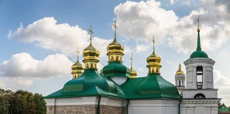 Churches and golden domes in Kyiv, Ukraine. Orthodox Christian Cathedral with golden domes and crosses. Church of the Savior on Berestov, Kiev-Pechersk Lavra.