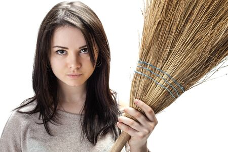 Cleanliness and homework Concept. Young woman with a broom 写真素材