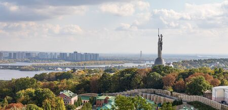 Aerial view on Kyiv city, Dnipro River, Motherland Monument and Kyiv Pechersk Lavra.