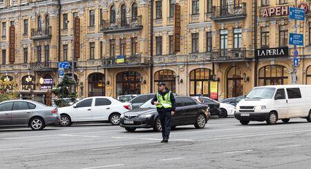 KYIV, UKRAINE - Sep 27, 2019: Street scene in Kyiv, the capital of Ukraine. A policeman regulates traffic in the center of Kiev on Khreshchatyk street Editorial