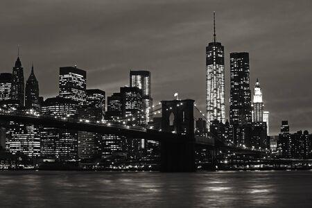 Manhattan and Brooklyn Bridge at night. Black and white image