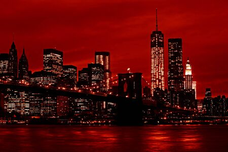 Manhattan and Brooklyn Bridge at night. Image in the dramatic red colors