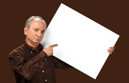 Senior man holds a blank board. Elder man holding blank canvas. Blank poster for text message or advertisement. 版權商用圖片