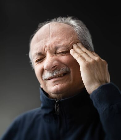 Portrait of an elderly man with a headache. Old man with infection and high temperature Stok Fotoğraf