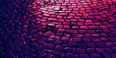 Streets of the old town. Stone paving texture. Abstract structured background. Image in trendy neon colors Banco de Imagens