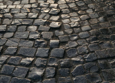 Streets of the old town. Stone paving texture. Abstract structured background. Banco de Imagens