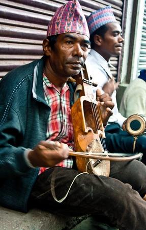 Darjeeling, India,june 21, 2011 - Street singers playing local folk songs.