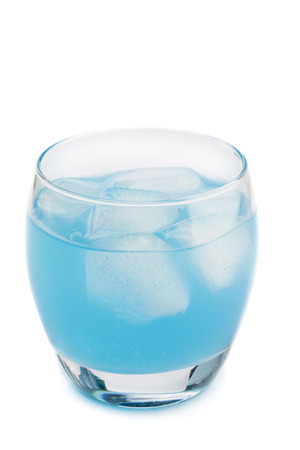 Chilled blue drink in lowball glass isolated on white