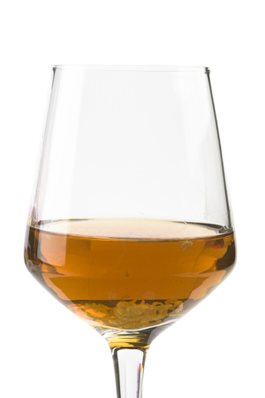 Glass with cognac isolated on white background