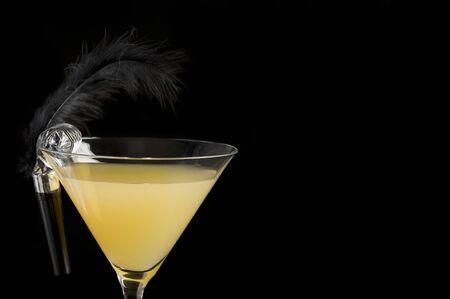 Flirtini cocktail isolated on black with copy space horizontal Фото со стока