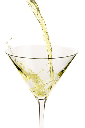 Green cocktail in martini glass on white background