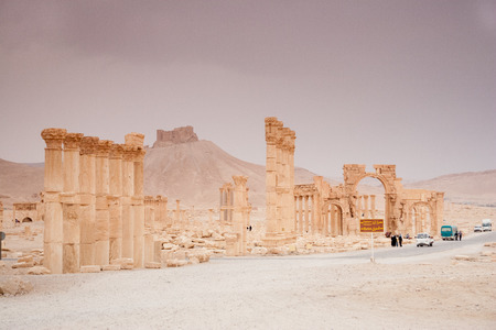 attested: Palmyra, Syria- November 28, 2008: Ruins of Palmyra city, Syrian desert. Dating back to the Neolithic era, the city of Palmyra, was a strategically located oasis first attested in the early second millennium BC as a caravan stop for travelers crossing the