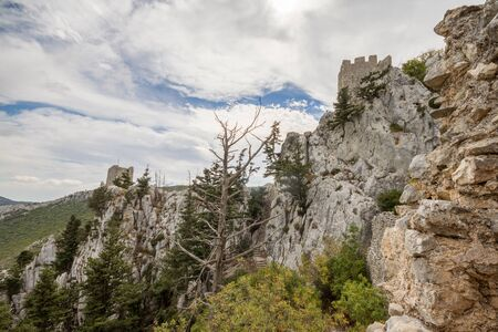 hilarion: Kyrenia mountains, Cyprus - October 22, 2014: The Saint Hilarion Castle lies on the Kyrenia mountain range, in Cyprus near Kyrenia. This location provided the castle with command of the pass road from Kyrenia to Nicosia. It is the best preserved ruin of t