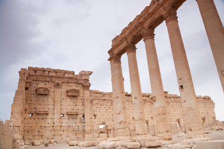 neolithic:  Ruins of Palmyra city, Syrian desert. Dating back to the Neolithic era, the city of Palmyra, was a strategically located oasis first attested in the early second millennium BC as a caravan stop for travelers crossing the Syrian Desert.  Stock Photo