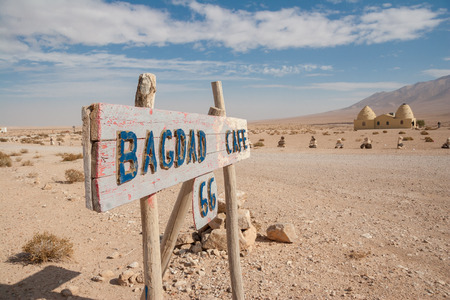 attested: Damascus- Palmyra road, Syria- November 28, 2008: Desert sign of a Cafe on the road from Damascus to Palmyra, Syria. Dating back to the Neolithic era, the city of Palmyra, was a strategically located oasis first attested in the early second millennium BC