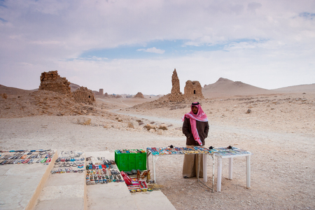 attested: Palmyra, Syria- November 28, 2008: Bedouin selling handcrafts at the site of the  ancient city of Palmyra, Syrian Desert. Dating back to the Neolithic era, the city of Palmyra, was a strategically located oasis first attested in the early second millenniu Editorial