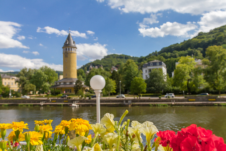ems: Flowers in a flower pot overlooking river Lahn and the spa town Bad Ems in Germany