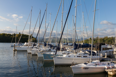 cumbria: Bowness-on-Windermere, United Kingdom - September 7, 2015: This is an  afternoon photo of Luxury Sail Yachts moored along a Pier  in Bowness-on-Windermere on Lake WIndermere in Cumbria