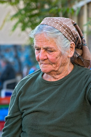 expressive: Nicosia, Cyprus - 15 November, 2003: A- Old lady in taditional village head-scarf