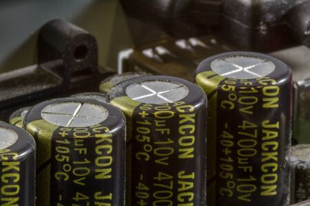 electrolytic: Close up of an array of Electrolytic Capacitors on a Printed Circuit Board PCB