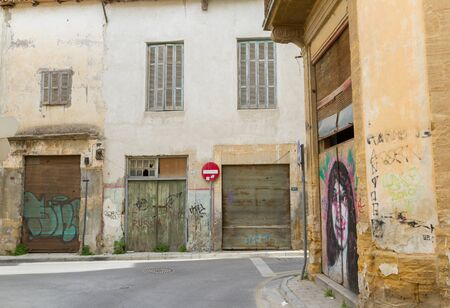 street corner: Nicosia, Cyprus - 18 February, 2016: Scenic streets and alleys in the Old Nicosia city centre. The old city of Nicosia within the Venetian Walls is a perfect place to walk in back alleys and abandoned areas, in search of derelict buildings with character