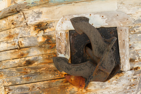 derelict: Anchor on Derelict Wooden Fishing Boat Wreck in Latsi, Cyprus Stock Photo