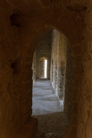 ancient prison: Atmospheric view inside a medieval castle corridor with daylight entering in onedirection and sideways