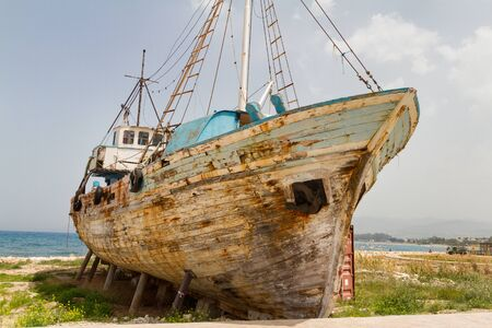 Old Derelict Wooden Fishing Boat Wreck in Latsi, Cyprus Stock Photo