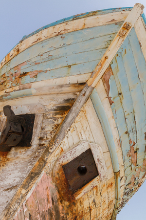 derelict: Diagonal Perspective of Old Derelict Wooden Fishing Boat Wreck in Latsi, Cyprus Stock Photo