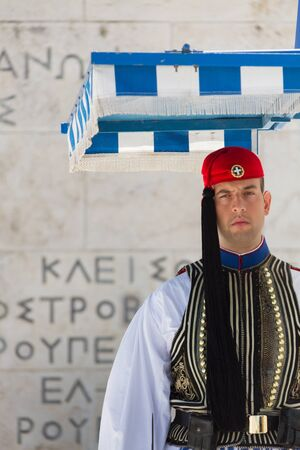 tomb of the unknown soldier: Athens, Greece - April 30, 2016: Soldier guards the Tomb of the Unknown Soldier at Syntagma Square, Athens, Greece Editorial