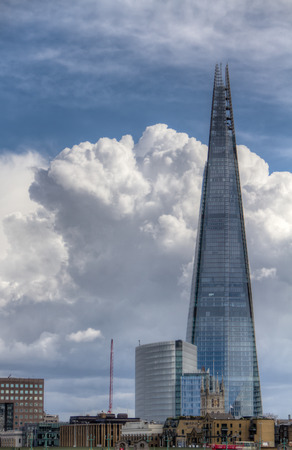 tallest bridge: London, United Kingdom - May 23, 2004:  The Shard of Glass Skyscraper dominating the London citiscape. Designed by Italian architect Renzo Piano has 95 storeys over a height of 309.6 metres .