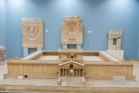 str: Palmyra, Syria- November 28, 2008: Small scale model (maquette) of the beautiful temple of Palmyra in Palmyra museum. It is saddening that Palmyras present Roman ruins, have come to be endangered in the 21st century by regional military and political str Editorial