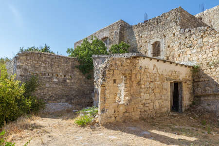 Old buildings in the traditional mountain village of Lofou in the Limassol district, Cyprus.  In Lofou ruins are sitting comfortably alongside renovated buildings. Stock Photo