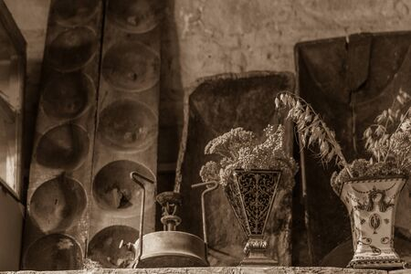 primus: Old Primus Stove, Vases and other traditional Cypriot village house interior  decoration in the mountain village of Lofou. Sepia toned photo.