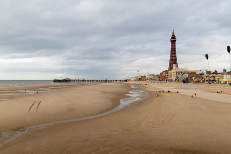 beachfront: View of the beachfront at Blackpool along the golden sands to the Blackpool Tower and North Pier Editorial