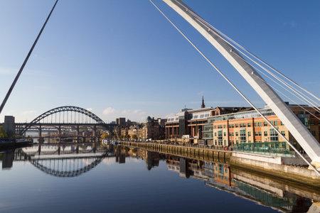 Newcastle Gateshead Quayside with River Tyne, Gateshead Millenium Bridge and Tyne Bridge in view