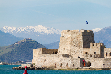 Venetian Castle Fortaleza de Bourtzi located on an island off the coast of Naplion with Mountains in the Background in Argolida, Greece