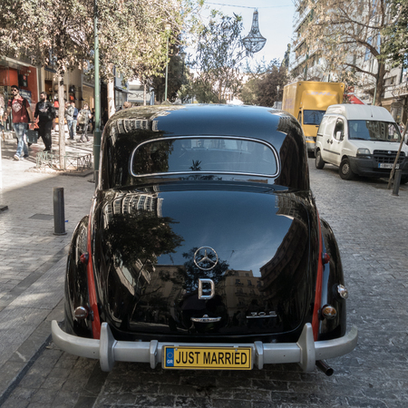 nafplio: Athens, Greece - 23 March, 2017:  Rear of Black Antique Mercees-Benz 170 S car parked on Ermou Street for use as a wedding limousine. The Mercedes-Benz 170 S was a luxury passenger car manufactured between 1949-1955.