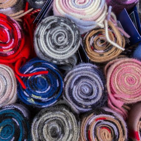 Top view of colorful Tartan Fabric rolls in a shop in Edinburgh, Scotland Stock Photo