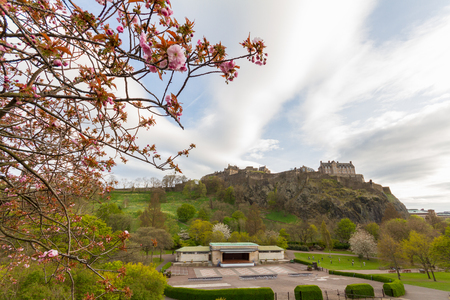 Edinburgh, Scotland - 19 April, 2017: Scenic view of  Princess Street Gardens in Edinburgh, with the Edinburgh Castle in the background on spring afternoon. The castle is a historic fortress which dominates the skyline of the city of Edinburgh. Editorial