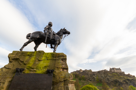 Edinburgh, Scotland - 19 April, 2017: Royal Scots Greys Memorial in Edinburgh, Scotland, with the Edinburgh Castle in the background on spring afternoon. The Royal Scots Greys was a cavalry regiment of the British Army from 1707 until 1971, when they amal Editorial