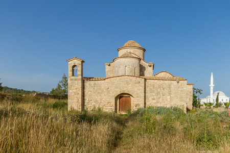 antiquity: Panayia Kanakaria 6th century Byzantine Monastery Church originally containing Kanakaria mosaics in Lythrangomi, Island of Cyprus bathed in afternoon light