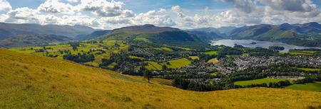 Wide panoramic view of Keswick and lake Derwent Water from Latrigg, Cumbria, UK Stock Photo