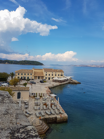 Corfu, Greece - 2 October, 2017: Elevated view of Faliraki beach area of Corfu city with visible autumn swimmers in the sea on a beautiful October day