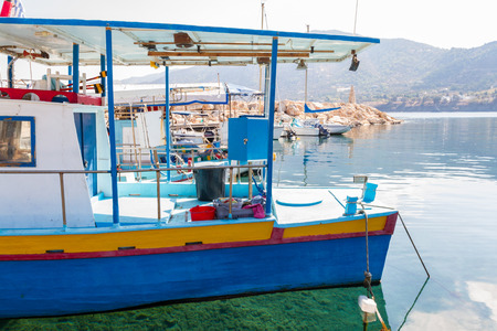 Fishing boats and crystal clear waters in Pomos harbour in the island of Cyprus