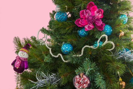 Decorated Christmas Tree with Prominent Snowman, Flower, Pomegranate and Ball Decoration 版權商用圖片
