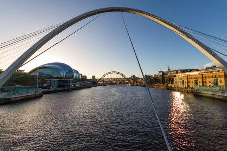 Newcastle Gateshead Quayside with River Tyne, Gateshead Millenium Bridge, Sage Gateshead concet hall and Tyne Bridge in view