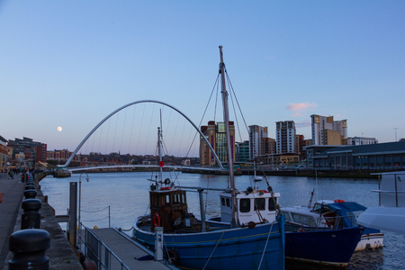 Newcastle Quayside with Gateshead Millenium Bridge, other landmarks  and Boat in sight