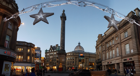 Newcastle, England - December 31, 2017: People around Greys Monument on Christmas decorated Grey Street in Newcastle at dusk on New Years eve Editorial